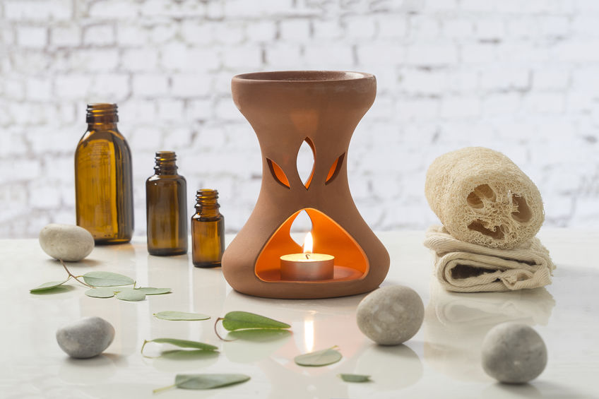 Aromatherapy votive candles burning in essential oil diffuser for wellness treatment in spa