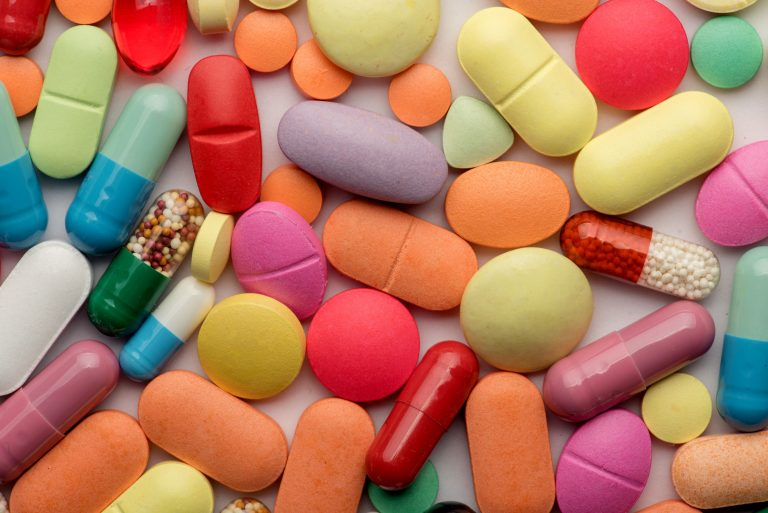 Multicolored tablets on white background
