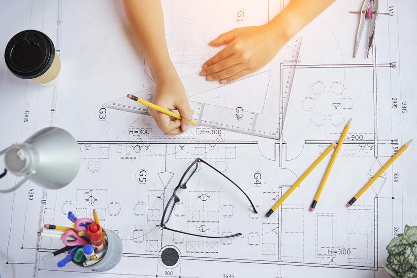 image of an architect working with blueprints