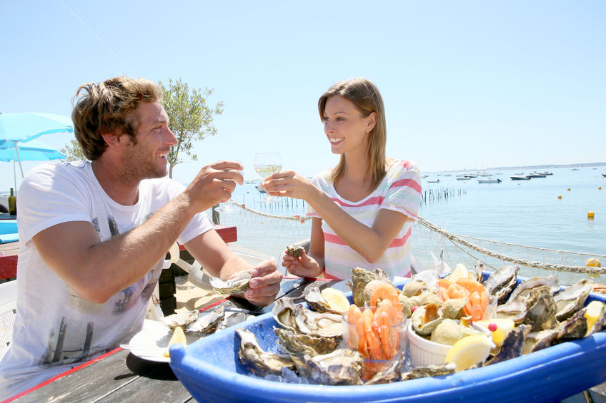 Couple drinking over seafood