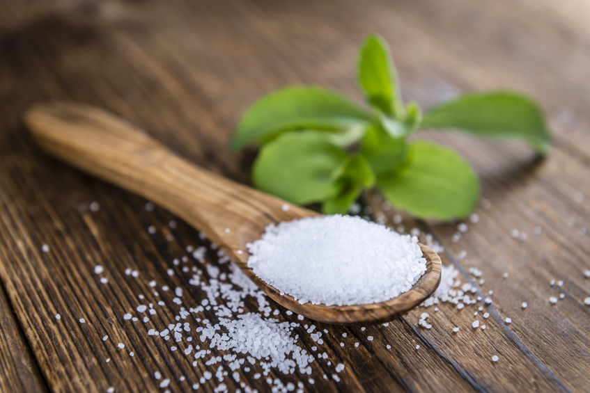 Old wooden table with Stevia Granules