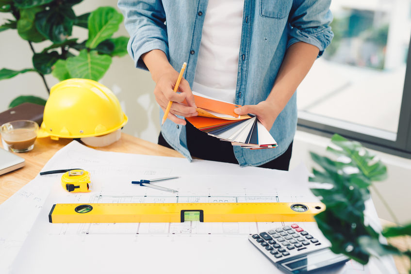 An architect working at a wooden table