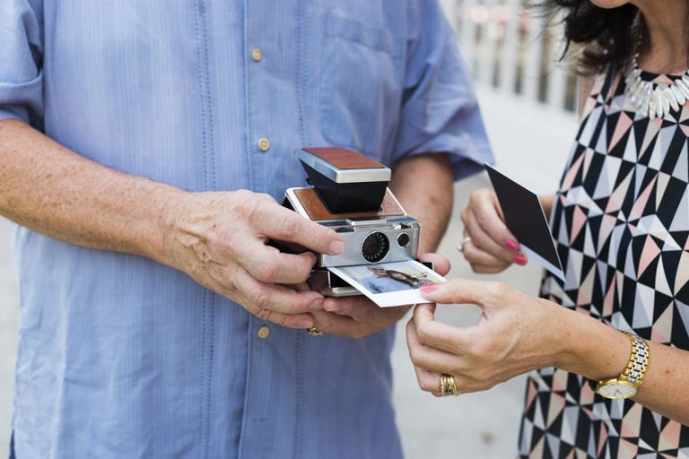 Couple printing a photo on instant camera
