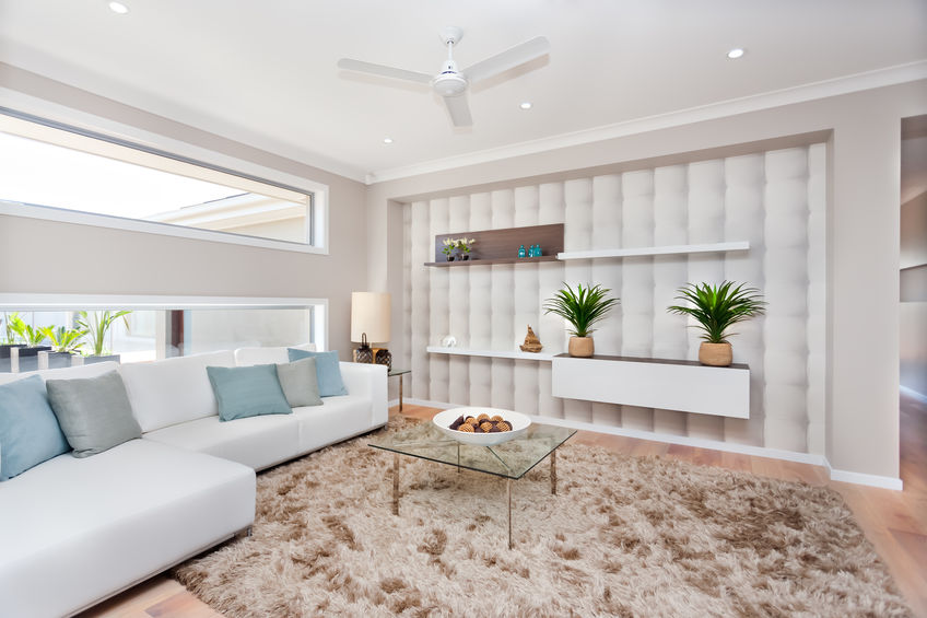 Living room in a luxurious house with natural decoration and whi