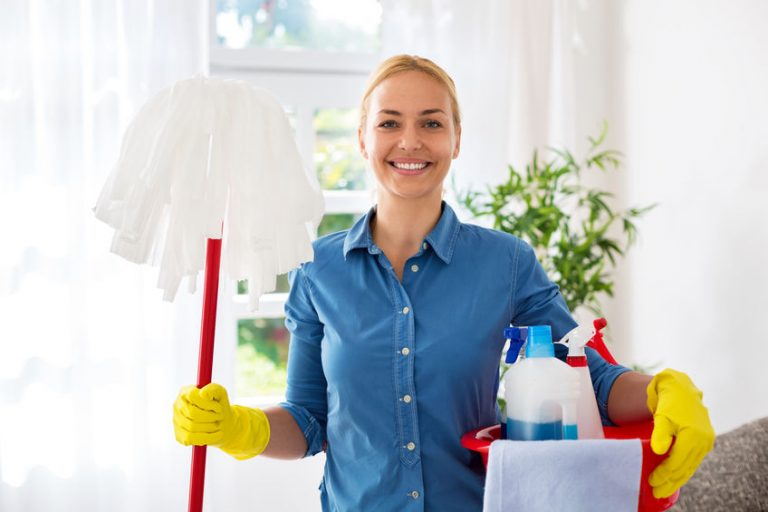 Smiling happy housewife ready for cleaning home