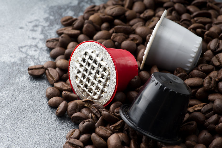espresso capsules on the coffee beans