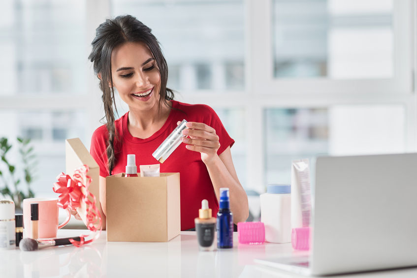 Cheerful girl making present with cosmetology