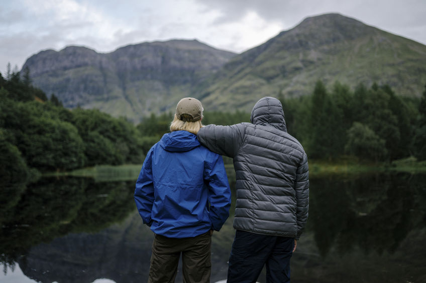 Friends standing by the riverside in the Highlands