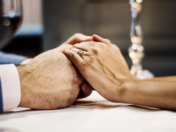 couple holding hands each other