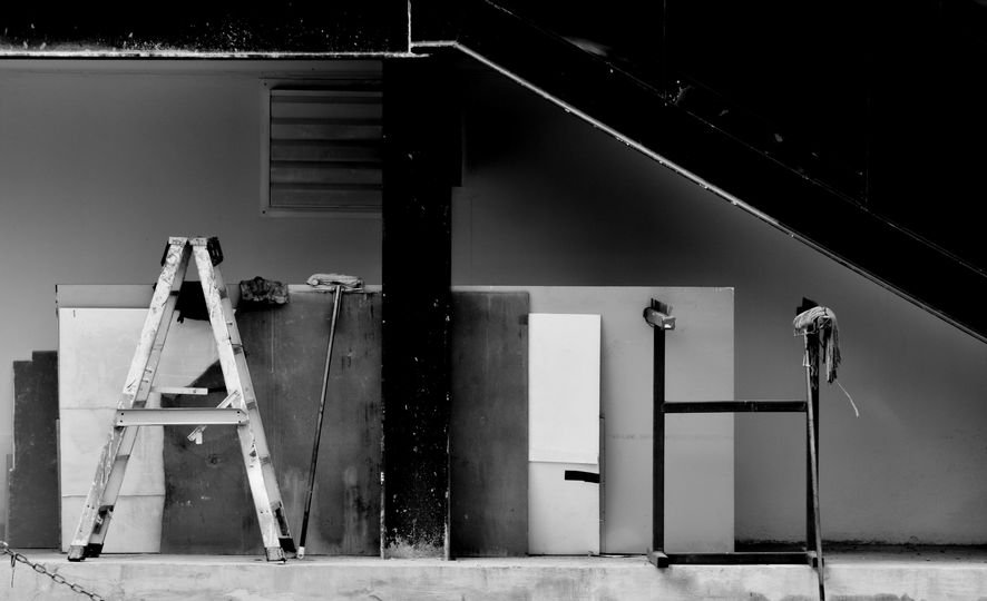 Folding ladder under the metal staircase - monochrome