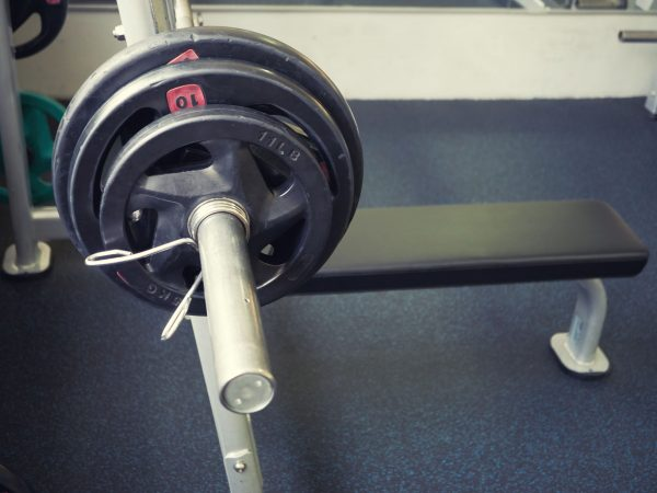 empty bench press with barbell full of heavy weights. high angle shot