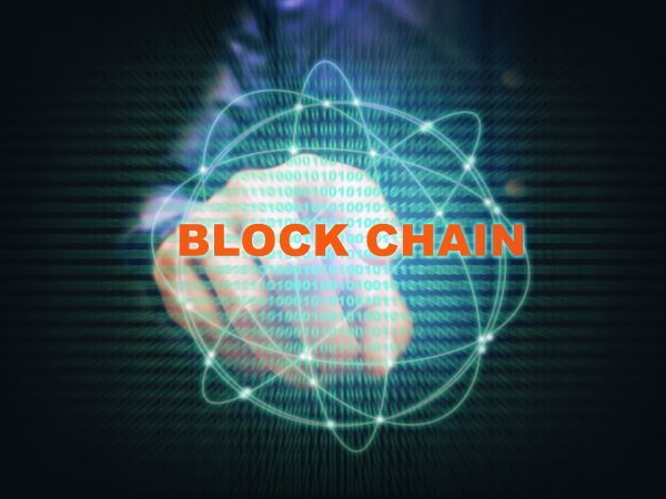 Asian young man pointing virtual screen blockchain connection and binary code on screen.
