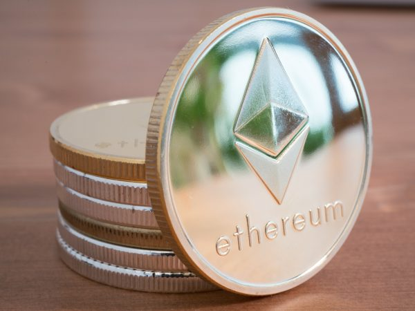 Pile of Real coin of cryptocurrency Silver Ethereum on wooden background