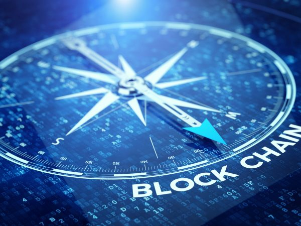 Block chain network concept – Compass needle pointing Blockchain word. 3d rendering